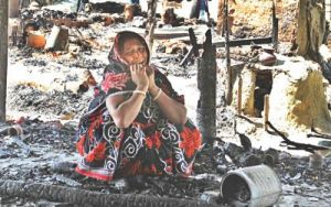Nipu Sheel wails sitting on the debris of her house that was set ablaze by Jamaat-Shibir men at Banshkhali in Chittagong. The religious fanatics looted and torched houses and temples of the Hindus in the district on Thursday, following the death sentence to Jamaat leader Delawar Hossain Sayedee. Photo: Anurup Kanti Das