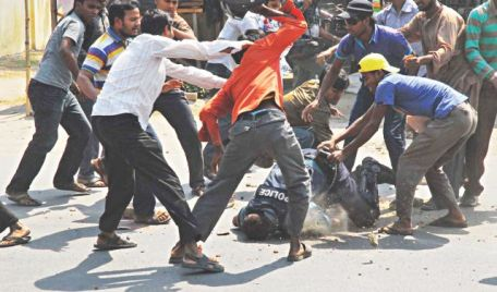 Rajshahi, Islami Chatra Shibir activists beat policeman with his helmet © Focus Bangla