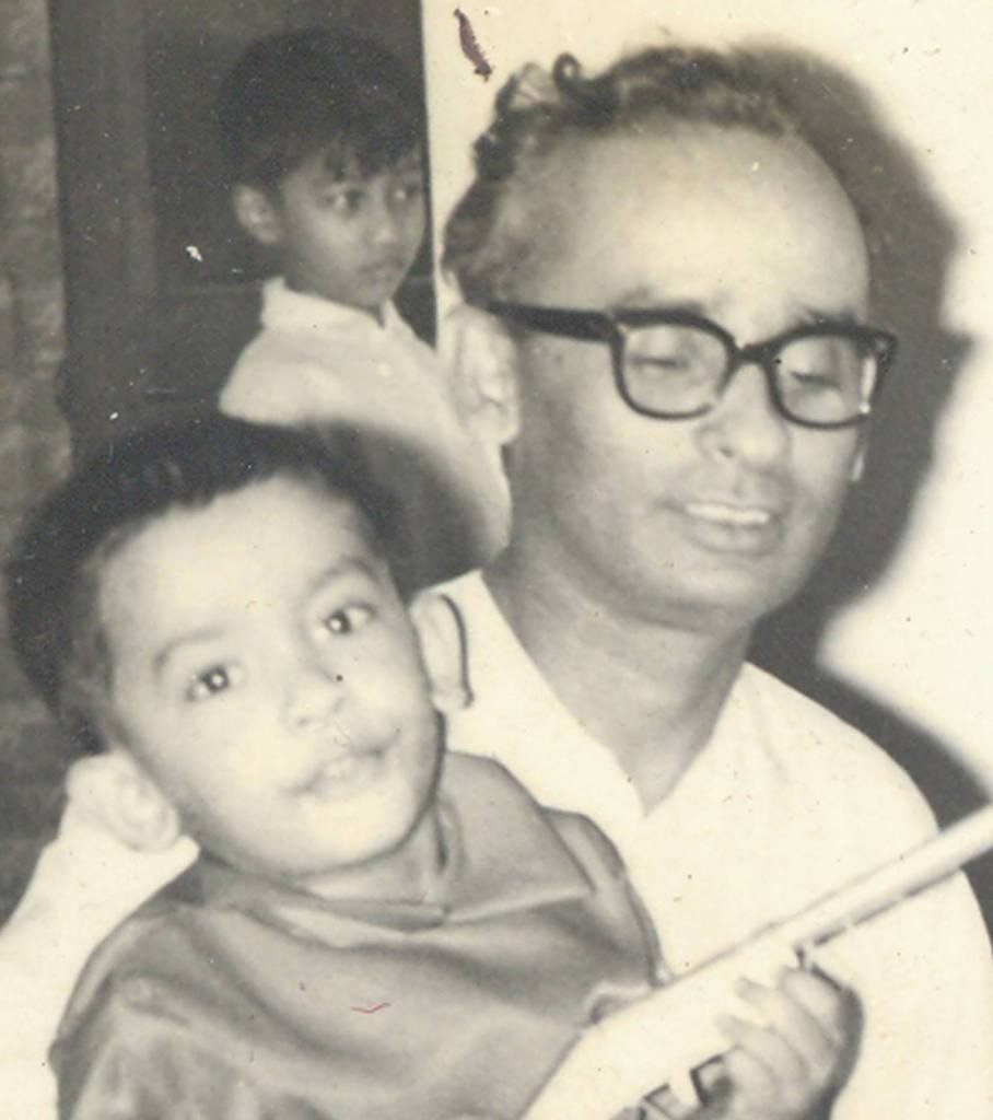 Tanvir Haider Chaudhury (age 3) with his father Prof. Mufazzal Haider Chaudhury. Source: Tanvir family album, with permission.