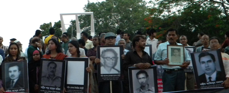 Children of intellectuals assassinated in 1971 hold silent vigil at Shaheed Minar.