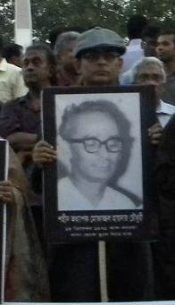 Tanvir Haide Chaudhury holds photo of his father at Shaheed Minar.