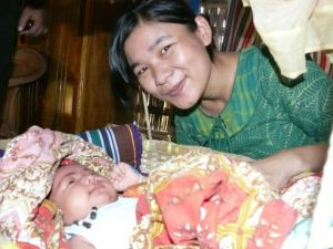 Ucha Chak with the new born baby Saba Chakma. Photo courtesy: Bayezid Hossain
