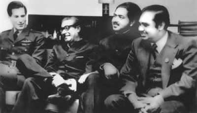 At Nicosia airport, Cyprus,  January 9, 1972, en route from London to Dhaka after release.  (left to right): Air Commodore David B Craig, UK Royal Air Force, Sheikh Mujibur Rahman, PM elect of Bangladesh, Dr Kamal Hossain, Minister for Law and Parliamentary Affairs,  Golam Mowla, Managing Director of Great Eastern Insurance Company Limited.