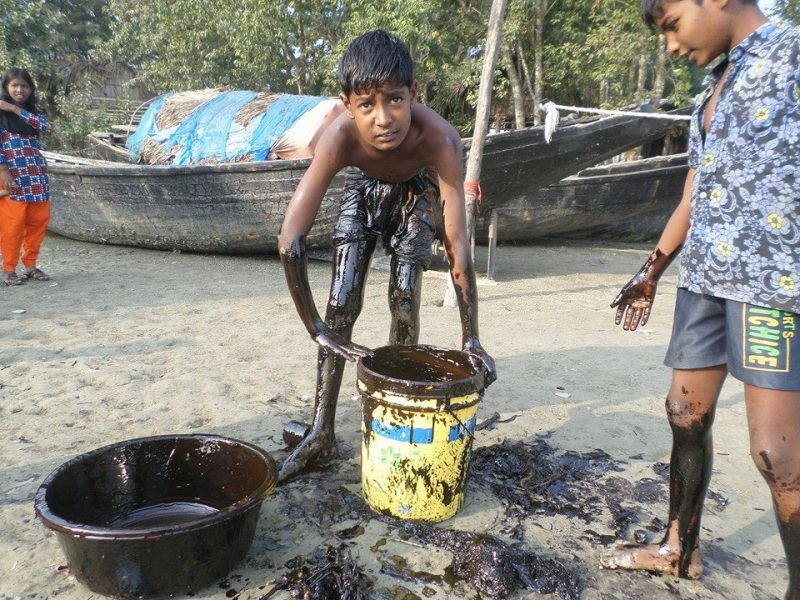 Kids and youths are picking up the oil with their bare hands.