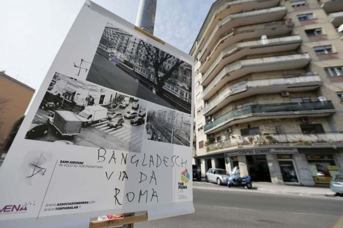 Nazi Swastika and anti-Bangladesh graffitti on poster. Source: roma.repubblica.it